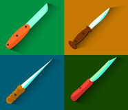 Sistema de cuatro cuchillos con las sombras largas Diseño plano Vector Imagen de archivo