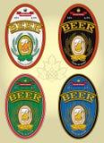 Sistema de cuatro etiquetas ovales para la cerveza libre illustration
