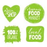 Sistema de cuatro etiquetas sanas de la comida con las letras Fotos de archivo libres de regalías