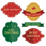Sistema de cuatro etiquetas y cintas de la Navidad del vector Fotografía de archivo