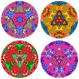 Sistema de cuatro mandalas coloridas redondas en un fondo blanco Imagen de archivo libre de regalías