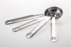 Sistema de cucharas dosificadoras del metal Fotografía de archivo