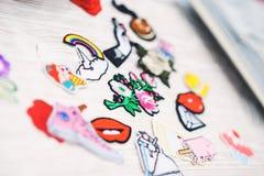 Sistema de diversas etiquetas engomadas del bordado en la ropa Imagen de archivo libre de regalías
