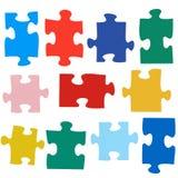 Sistema de diversos pedazos coloreados del rompecabezas Imágenes de archivo libres de regalías