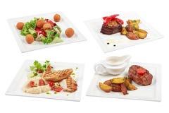 Sistema de 4 diversos platos aislados en el fondo blanco Fotos de archivo libres de regalías