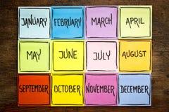Sistema de doce meses en notas pegajosas Imagen de archivo libre de regalías