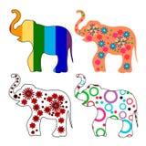 Sistema de 4 elefantes multicolores Imagenes de archivo