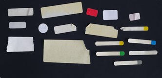 Sistema de etiquetas engomadas adhesivas sucias fotografía de archivo