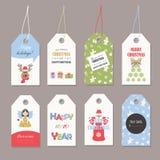 Sistema de etiquetas lindo de la Navidad con brillo Fotos de archivo libres de regalías