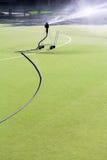 Sistema de extinção de incêndios no futebol artificial fotografia de stock