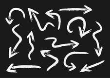 Sistema de flechas blancas pintadas con un cepillo grunge Fotografía de archivo libre de regalías