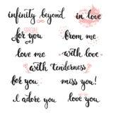 Sistema de frases dibujadas mano sobre amor: en amor, le adoro Foto de archivo libre de regalías
