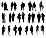 Sistema de gente y de niños que caminan de la silueta. Fotografía de archivo libre de regalías