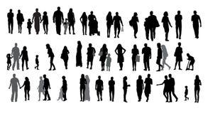Sistema de gente y de niños que caminan de la silueta. ilustración del vector