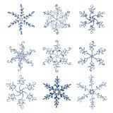 Sistema de hecho a mano caligráfico de los copos de nieve de la Navidad del ejemplo del vector del vintage stock de ilustración