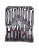 Sistema de herramientas en una caja de herramientas gris Fotografía de archivo