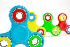 Sistema de hilanderos coloridos de la persona agitada Foto de archivo