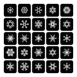 Sistema de iconos blancos y negros cuadrados del copo de nieve en blanco Imagen de archivo
