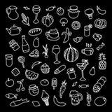 Sistema de 55 iconos en el tema de la comida, de diversos platos y de las cocinas Foto de archivo