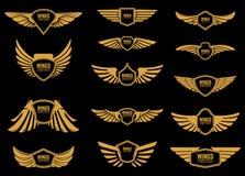 Sistema de iconos de las alas en estilo de oro Diseñe los elementos para el logotipo, etiqueta, emblema, muestra Foto de archivo libre de regalías