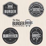 Sistema de insignias, de la bandera, de etiquetas y del logotipo para la hamburguesa, tienda de la hamburguesa Diseño simple y mí Imagen de archivo