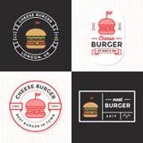Sistema de insignias, de la bandera, de etiquetas y del logotipo para la hamburguesa, tienda de la hamburguesa Diseño simple y mí Imagen de archivo libre de regalías