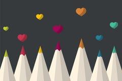Sistema de lápices coloreados con los corazones de la tarjeta del día de San Valentín Foto de archivo