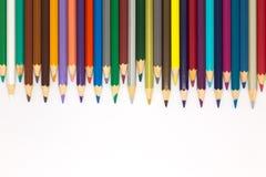 Sistema de lápices de los colores en el fondo blanco Imagen de archivo libre de regalías