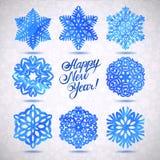 Sistema de la Feliz Navidad de los copos de nieve de la acuarela y de la Feliz Año Nuevo Fotografía de archivo libre de regalías