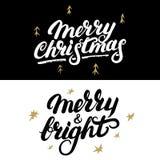 Sistema de la Feliz Navidad y de la mano feliz y brillante escritas las letras Imagenes de archivo