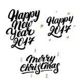 Sistema de la mano de la Feliz Año Nuevo 2017 y de la Feliz Navidad escrita las letras Fotos de archivo libres de regalías