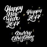 Sistema de la mano de la Feliz Año Nuevo 2017 y de la Feliz Navidad escrita las letras Imágenes de archivo libres de regalías