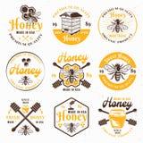 Sistema de la miel y del colmenar de emblemas coloreados del vector libre illustration