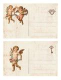 Sistema de la postal antigua del ` s de la tarjeta del día de San Valentín del estilo dos que ofrece el cupido y el corazón fotografía de archivo libre de regalías