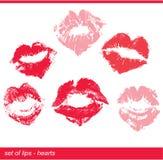 Sistema de labios rojos hermosos en la impresión de la forma del corazón Foto de archivo libre de regalías