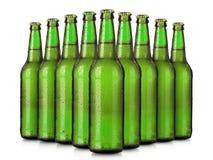 Sistema de las botellas de cerveza con descensos escarchados aisladas Foto de archivo libre de regalías