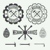 Sistema de las etiquetas de la carpintería y del mecánico del vintage, de los emblemas y del logotipo Imagen de archivo libre de regalías