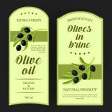 Sistema de las etiquetas para el aceite de oliva con las ramas de aceitunas negras Vector las etiquetas engomadas usadas para hac Imágenes de archivo libres de regalías