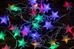 Sistema de las luces de la Navidad que brillan intensamente para el diseño de las tarjetas de felicitación del día de fiesta de N Fotografía de archivo libre de regalías