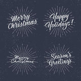 Sistema de letras de la Navidad, de deseos y de etiquetas del vintage Season& x27; caligrafía de los saludos de s Diseño de la ti Fotos de archivo