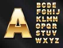 Sistema de letras de oro brillantes Fotografía de archivo