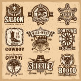 Sistema de logotipos del oeste salvajes del vector Imágenes de archivo libres de regalías