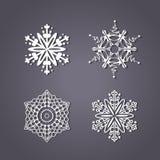 Sistema de los copos de nieve blancos en el fondo gris Imagen de archivo libre de regalías
