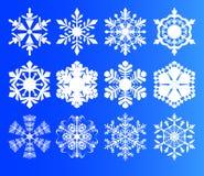 Sistema de los copos de nieve blancos en un fondo azul para el diseño Fotografía de archivo