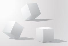 Sistema de los cubos blancos en diversas proyecciones Imagenes de archivo