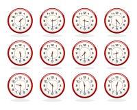 Sistema de los relojes rojos por horas de oficina Mitad más allá de la versión de las horas Imágenes de archivo libres de regalías