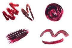 Sistema de manchas hechas con el lápiz labial rojo Fotos de archivo libres de regalías