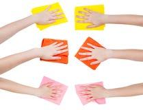 Sistema de manos con los diversos trapos aislados Fotos de archivo libres de regalías