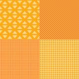 Sistema de modelos inconsútiles de los recuadros rayados y Naranja con colores amarillos Plantillas del fondo de la bandera del v Imagen de archivo libre de regalías