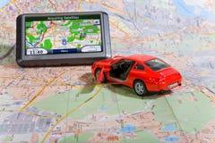 Sistema de navegação do GPS em um mapa de viagem Fotografia de Stock Royalty Free